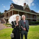 Dr Bill Wallace and Lyn Mackay in costume as Mr and Mrs Waite on the lawns of Urrbrae House