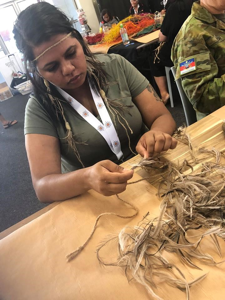 Linikka, working with the emu feathers as part of the Statewide Aboriginal Women's Leadership Gathering.