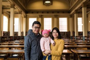 Rupa with husband and daughter in Barr Smith Library