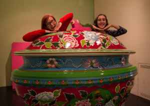 A giant teapot and two students