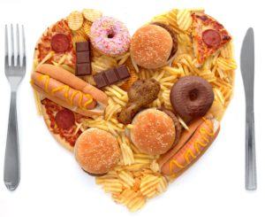 Heart shape made of junk food