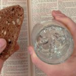 Bible with bread and water