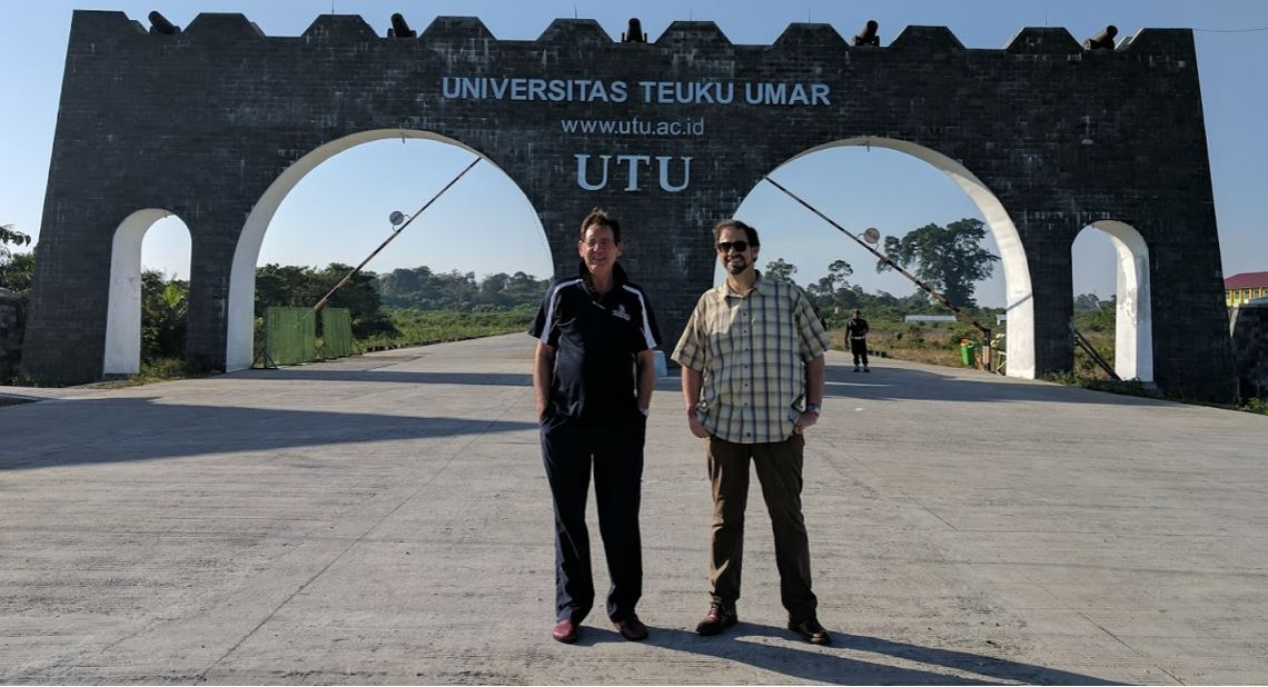 Dr Barry Elsey and Dr Adam Loch at the front gate to UTU