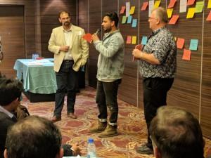 Dr. Adam Loch and Dr. Jay Cummins with Ramanpreet Singh, a farmer from Punjab