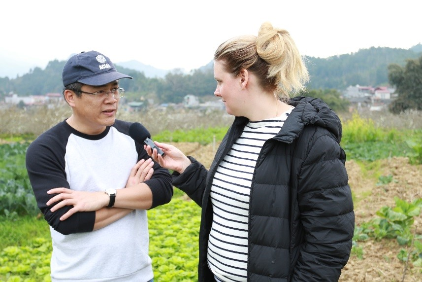 Cassie Hough, ABC Rural interviewing Dr Tran Minh Tien, Deputy Director of the Soil and Fertiliser Research Institute in Hanoi, Vietnam, in a field in Bac Ha District, Lao Cai Province, Vietnam.