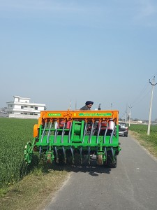 A farmer with his Happy Seeder machine in Punjab, India