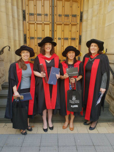 PhD graduates Claire Settre and Rio Maligalig with their respective supervisors Prof. Sarah Wheeler and Prof. Wendy Umberger