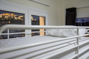 Dorm bed with the Acropolis in the window.