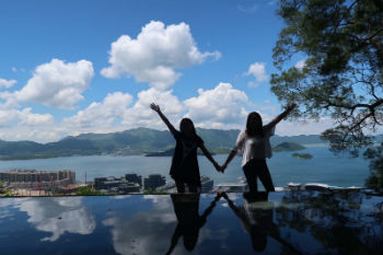 Posing by the Infinity Pool on campus at CUHK