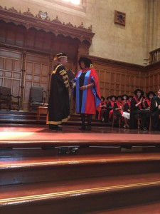 Andrea Mason receiving her doctorate from the Chancellor The Hon Keven Scarce AC CSC RAN (Rtd)
