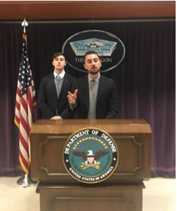 Riley Ingham and Nicholas Garbas at the Pentagon podium